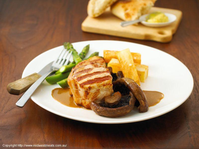 Pork Steaks with Homemade Chips & Mushrooms