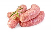pork_sausages_with_a_sprig_of_rosemary__isolated_on_a_white_background
